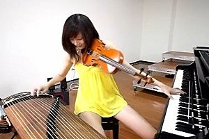 Watch a Taiwanese Musician Play Three Instruments at Once